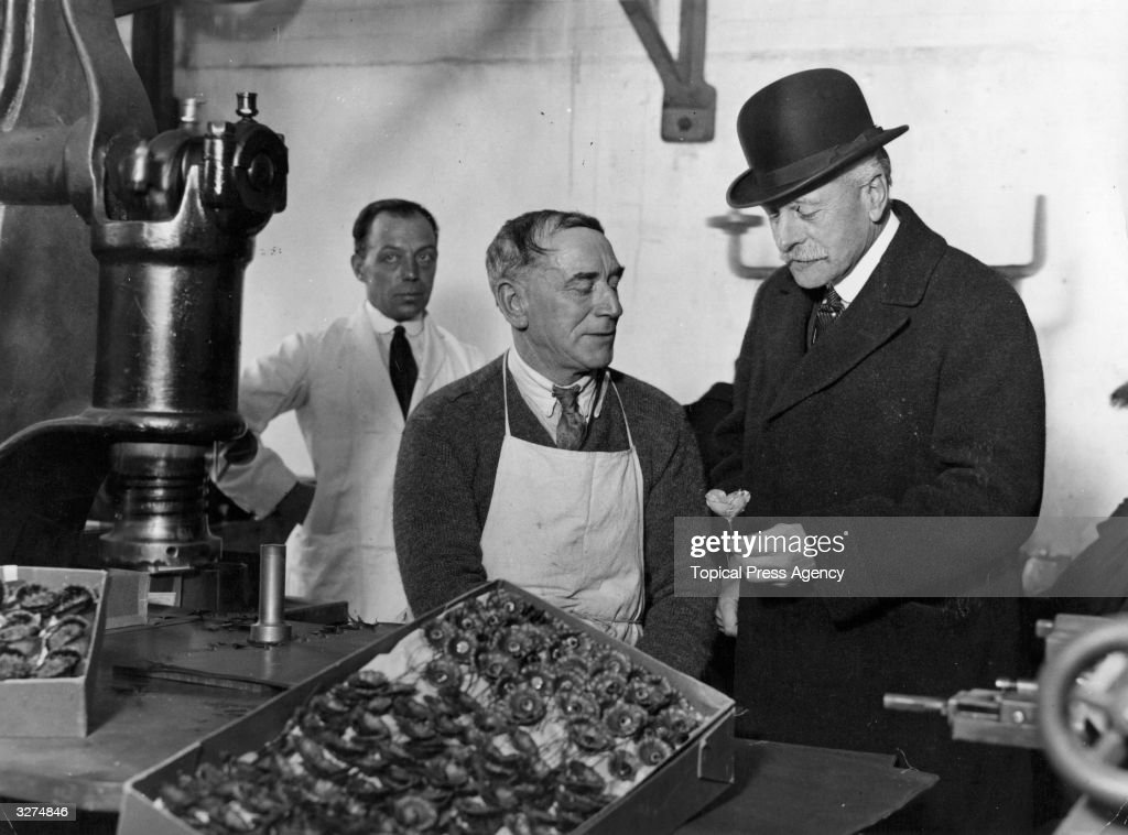 Earl Haig (1861 - 1928) watches the stamping of poppies by ex-servicemen, during a visit to the British Legion poppy factory at Richmond. Haig, born in Edinburgh, was educated at Oxford and the Royal Military College at Sandhurst before embarking on his military career. He served in India and was then given command of the 1st Army Corps of the British Expeditionary Force in France and Belgium when hostilities began in 1914. He was promoted to General in the same year and eventually assumed command of the BEF. The British Prime Minister, Lloyd George, criticised Haig's handling of the battle of the Somme in 1916 and his command at Passchendale in 1917 but on his return from World War I Haig became commander in chief of home forces and was made Earl Haig (1919) and later Baron Haig of Bemersyde (1921).