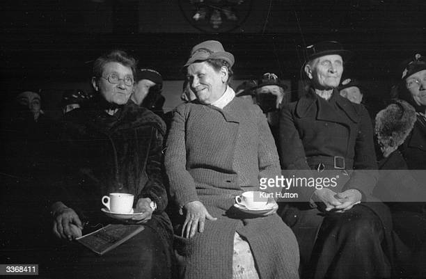 A group of women drinking tea together at a meeting of their 'Grandmothers' Club' at Victoria's Dock Mission East London Original Publication Picture...