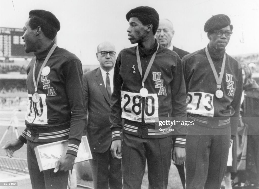 Olympic medal winning, Afro-American atheletes for the 400 meters (from left to right) Lee Evans (gold), Larry James (silver), and Ron Freeman (bronze). The three wear black berets in sympathy for their suspended compatriots Tommie Smith & John Carlos who controversially gave the Black Power salute as the American national anthem was played during the medal ceremony for the 200 meters.