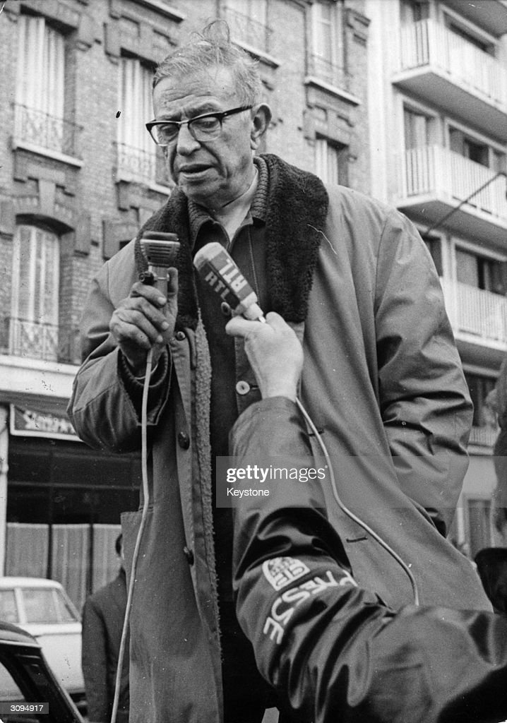 French philosopher Jean-Paul Sartre (1905 - 1980) addressing Renault car workers on the subject of 'violence by the people'.