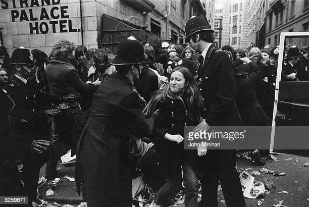 Fans break through the police cordon at the queue for concert tickets for the British group 'The Who' in London