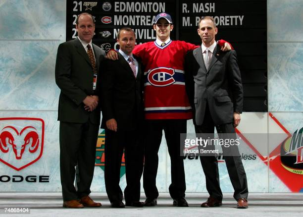 22nd overall pick Max Pacioretty of the Montreal Canadiens poses with team personnel after being drafted in the first round of the 2007 NHL Entry...