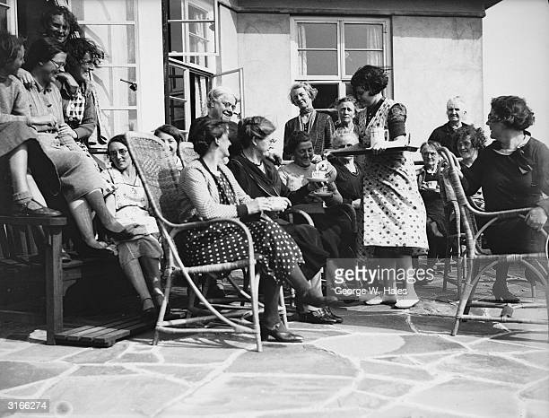 A group of mums enjoy a wellearned break at a girls' camp in Boverton south Wales