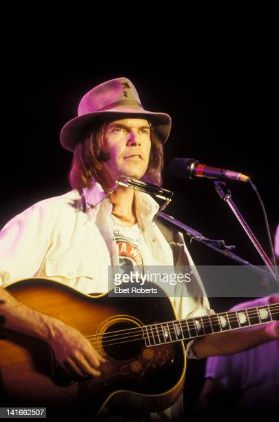 Canadian singersongwriter Neil Young performs live on stage at Farm Aid benefit concert in Champaign Illinois on 22nd September 1985