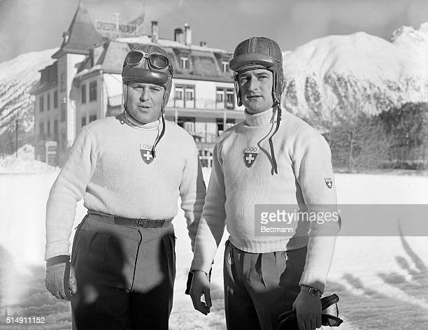 2/3/1948StMoritz Switzerland These two daredevils members of the Swiss Olympic bobsled squad congratulate each other after winning the twoman bobsled...