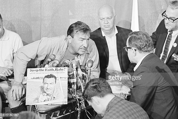 2/3/1967Bimini Bahamas Leaning over a battery of microphones congressman Adam Clayton Powell answers a reporter's question during a press conference...