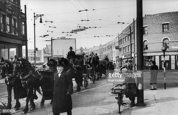 The oldstyle funeral procession of Battersea street trader Jim Lloyd starting in London's Battersea and ending up at Wandsworth Cemetery A passerby...