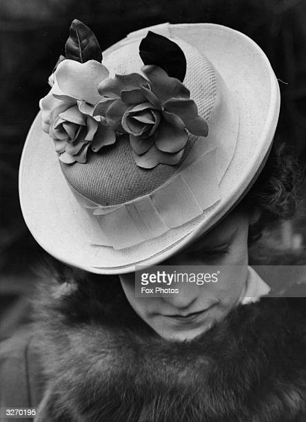 Young lady sports a St George's day hat with roses