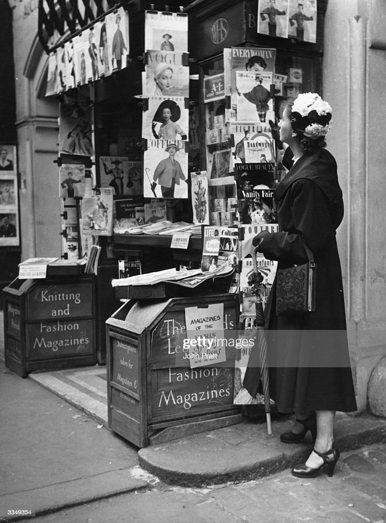 On a Bond Street bookstall in London fashion magazines showing the latest Paris collections dominate the stall
