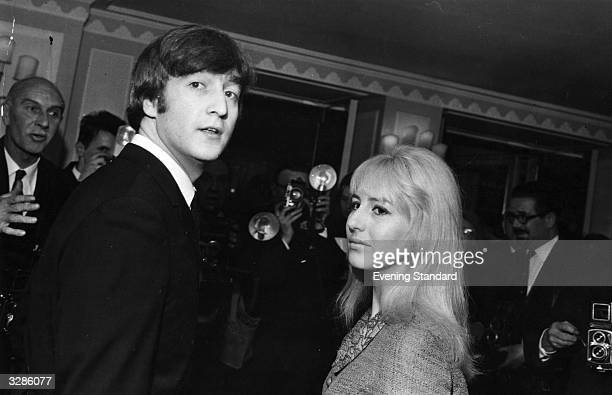 Singersongwriter John Lennon of The Beatles with his wife Cynthia at the Dorchester Hotel London for a Foyles Luncheon after the publication of his...