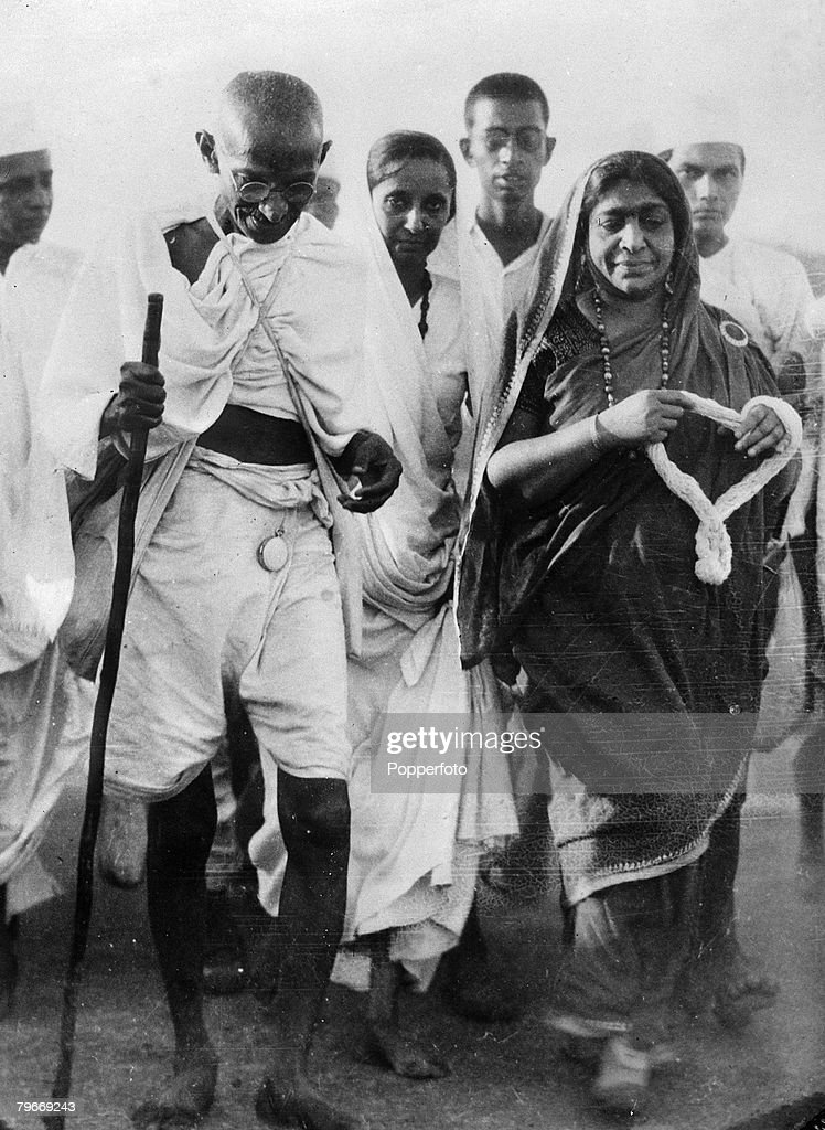 23rd April Indian spiritual leader Mahatma Gandhi accompanied by Mrs Sarojini Naidu at Dandi India en route to breaking the Salt Laws at the end of...