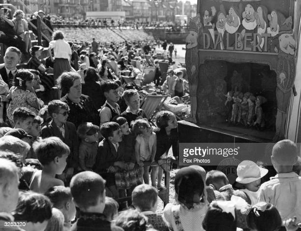 A Punch and Judy show of Snow White and the Seven Dwarfs at Morecambe beach