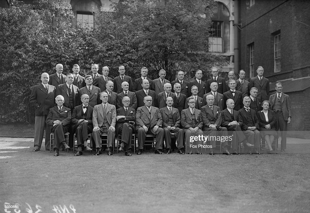 The new Labour Cabinet in the garden of 10 Downing Street, London. Back row, L-R: The Rt Hon William Whiteley (Parliamentary Secretary to the Treasury), Sir Edward Bridges (Chief Whip), Sir F Soskise (Solicitor General), J B Hynd (Chanc