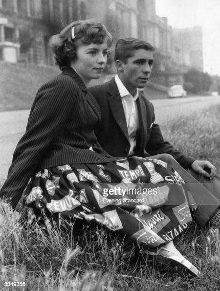 Teenagers Brian Cousins and Jean Ringforth of Hornsey in London spend the afternoon in Alexandra Park London Jean is wearing a skirt printed with the...
