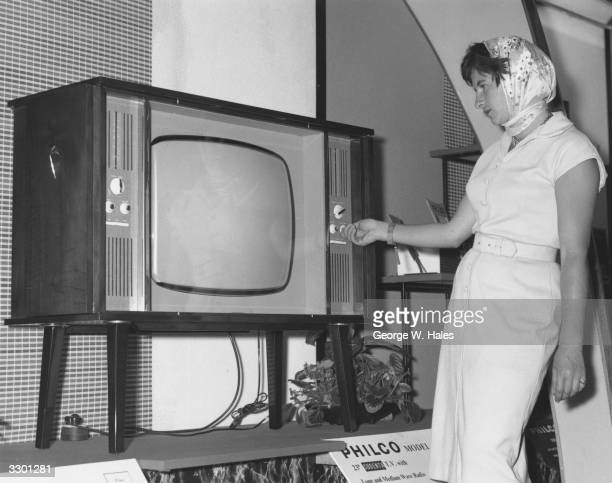 Tilde Bradshaw with a Philco 1065 television which has a 23inch screen at the annual Radio and Television Show at Earl's Court London
