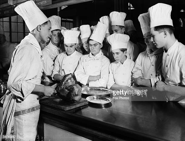 Trainee chefs watching a display of turkey carving at the Westminster Technical Institute in Vincent Square London
