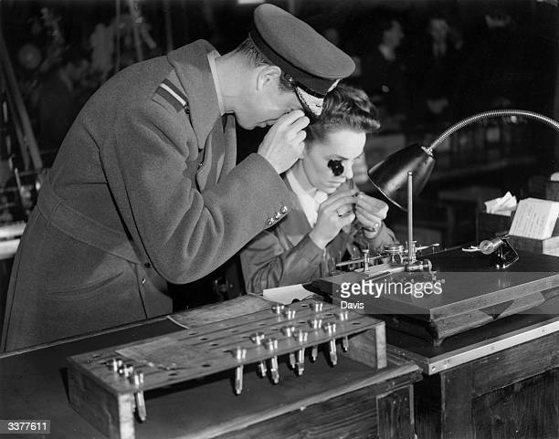 His Royal Highness George Edward Alexander Edmund the Duke of Kent inspecting a small aircraft part in a London factory
