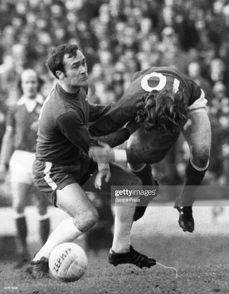 Ron Harris of Chelsea fouls Queens Park Rangers' Stan Bowles during their match at Stamford Bridge.