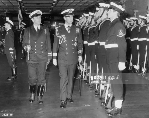 Charles Prince of Wales reviewing the Royal Guard of HMS Bulwark during the ship's recommissioning