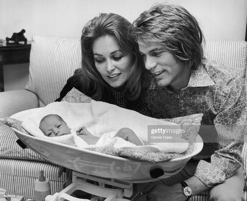 Pop singer and actor Adam Faith (1940 - 2003) at his home in Henfield, Sussex with his wife Jackie Irving and their five-week old daughter Katya, who was born prematurely, but has put on two pounds since her birth.