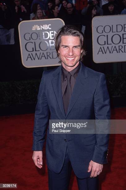 American actor Tom Cruise standing on the red carpet at the 57th annual Golden Globe Awards where he won the award for Best Supporting Actor for his...