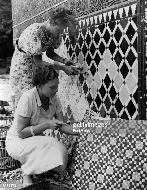 Women working on mosaics from the famous Alhambra Court at Crystal Palace London They are to be sold as souvenirs at a garden fete in aid of St...