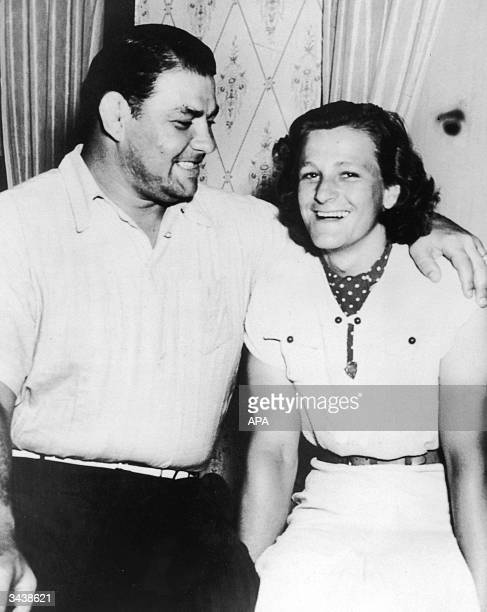 American wrestler George Zaharias and American athlete Mildred 'Babe' Didrikson pose together after announcing their engagement Beaumont Texas