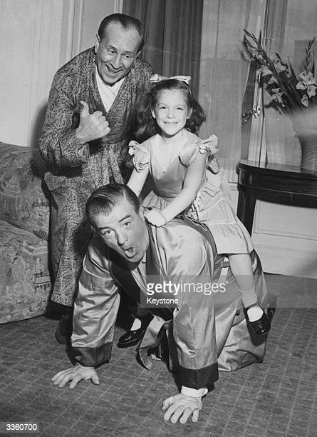 American comedy duo Bud Abbott smiling as Lou Costello gives his daughter Christie a piggy back ride The pair starred in over 35 films together