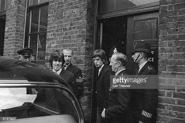 British musicians Mick Jagger and Keith Richards of the Rolling Stones leave West Ham magistrates court where they appeared on drug charges