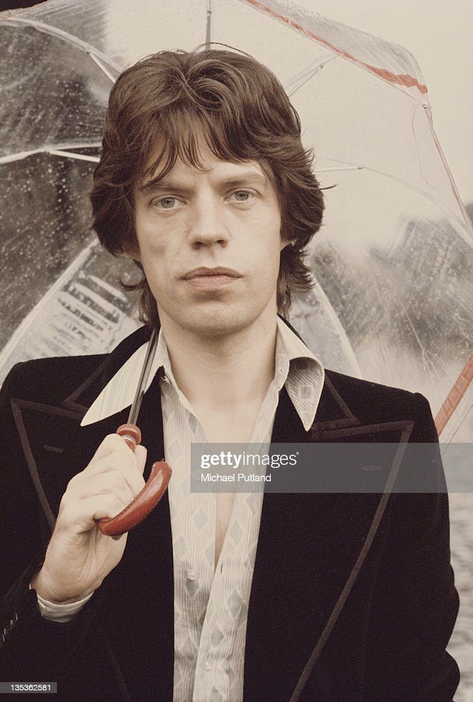 Singer <a gi-track='captionPersonalityLinkClicked' href=/galleries/search?phrase=Mick+Jagger&family=editorial&specificpeople=201786 ng-click='$event.stopPropagation()'>Mick Jagger</a> of the Rolling Stones posed holding an umbrella at Carmarthen Castle in Wales on 23rd July 1973.