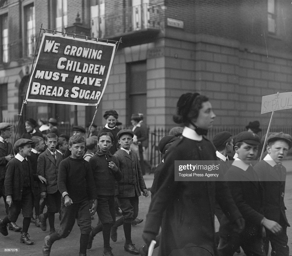 A children's rally in west London supporting prohibition. A banner they are carrying reads, 'We Growing Children Must Have Bread & Sugar'.