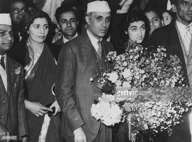 Pandit Jawaharlal Nehru in London for discussions With him is his daughter Indira