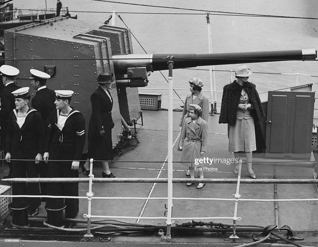 Princesses Elizabeth and Margaret Rose (1930 - 2002) on board the Royal Navy destroyer Kempenfelt at Portsmouth, waiting to sail to the Solent to meet their parents, King George VI and Queen Elizabeth.
