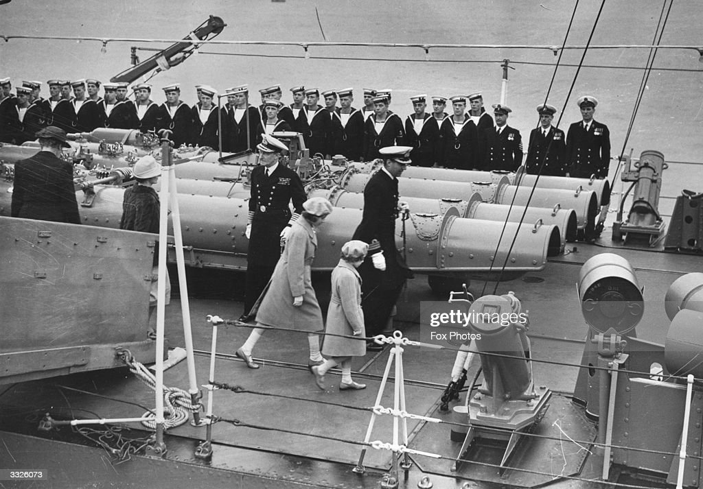 The Royal Princesses Elizabeth and Margaret (1930 - 2002) going aboard the destroyer Kempenfelt to meet their parents in the Solent.