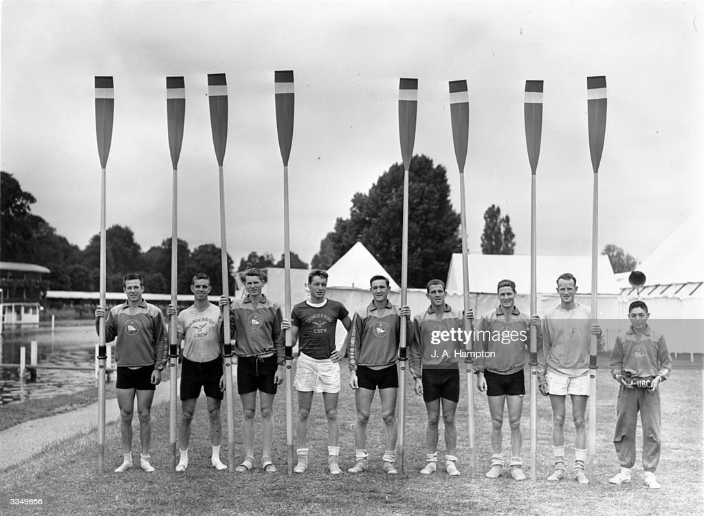 Members of the Canadian University Boat Club rowing team holding their oars at HenleyonThames Oxfordshire where they are competing in the Regatta