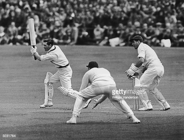 Australian batsman Neil Harvey straight drives the delivery during a tour match between Australia and Sussex at Hove Original Publication Picture...
