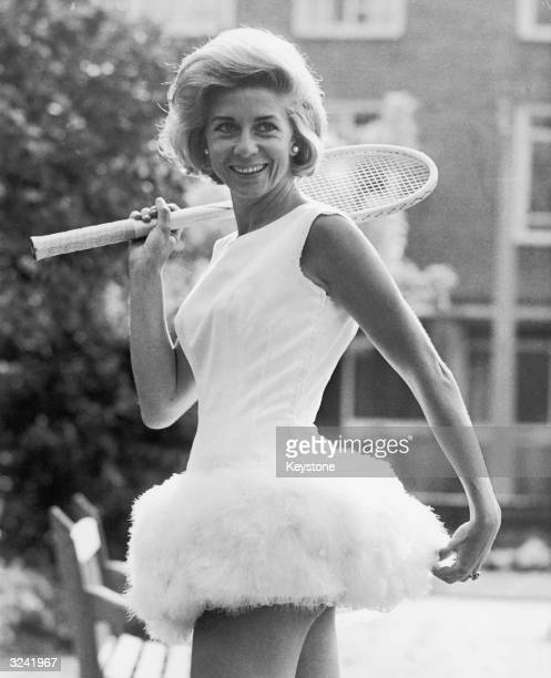 Italian tennis star Lea Pericoli wearing a tennis dress trimmed with feathers designed by British sportswear designer Teddy Tinling