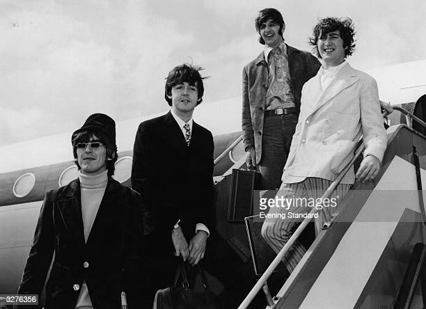 The Beatles left to right George Harrison Paul McCartney Ringo Starr John Lennon arriving at London Airport