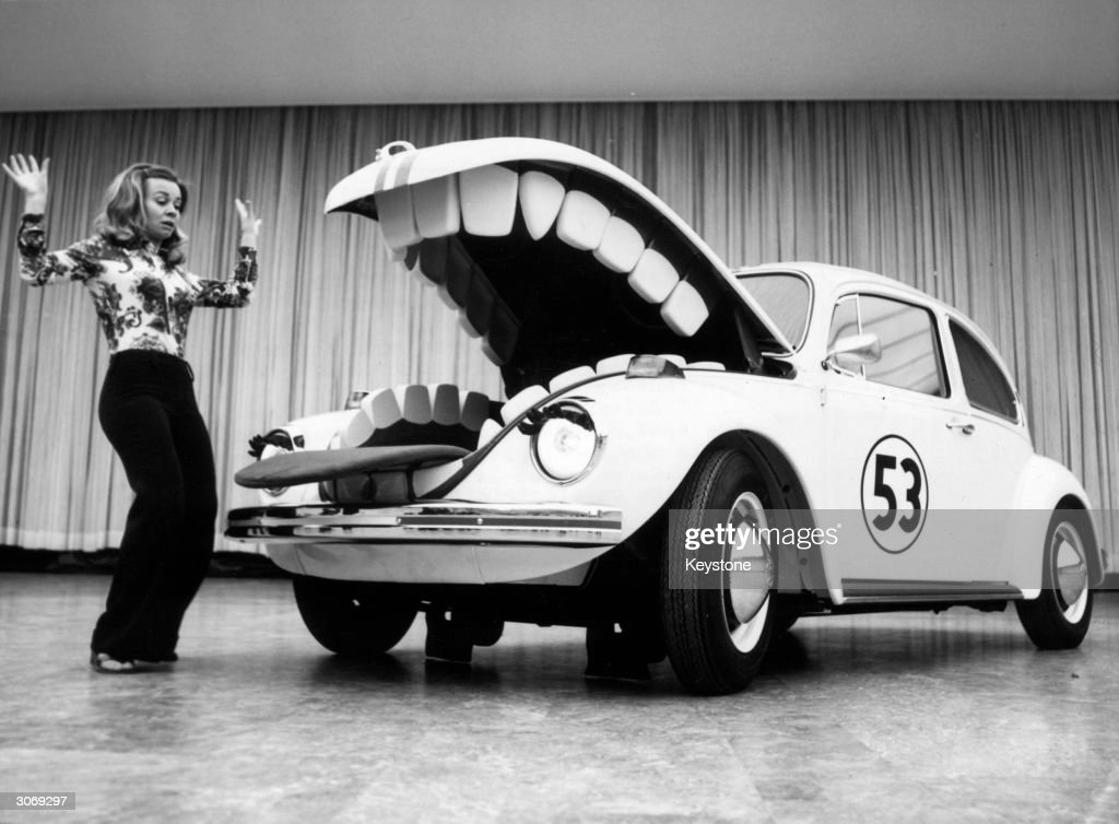 Herbie, the anthropomorphic Volkswagen featured in the Disney film 'The Love Bug' and its sequels terrorises a young woman at a motorshow in Berlin.