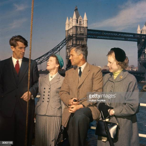 Mountaineer Edmund Hillary with explorer Dr Vivian Fuchs and his wife and daughter on board the 'Theron' after its return from the Antarctic during...