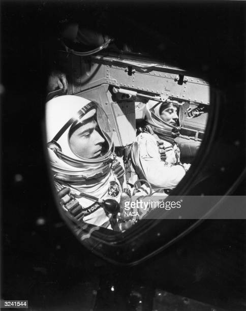 American astronauts John W Young and Virgil 'Gus' Grissom sitting in the GT3 spacecraft just before the hatches were closed in the Gemini flight...