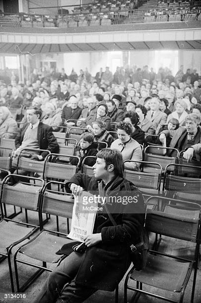 A supporter of the Welsh nationalist party Plaid Cymru in the crowd at Shrewsbury where the British politician and Deputy Leader of the Labour Party...