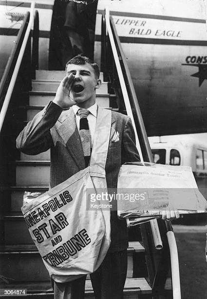 15yearold paperboy Donal Olson arrives at London Airport to deliver three copies of the Minneapolis Sunday Tribune to the Lord Mayor of London US...