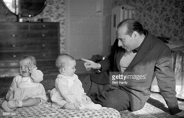 Italian film director Roberto Rossellini making a point to his elevenmonthold twins Original Publication Picture Post 6514 Ingrid Bergman's Story pub...