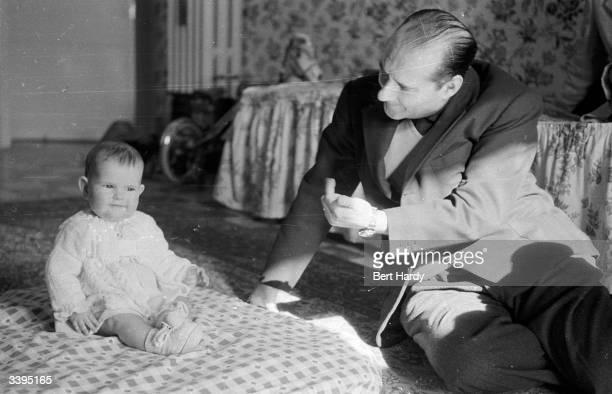Italian film director Roberto Rossellini with his 11monthold daughter Isabella Original Publication Picture Post 6514 Ingrid Bergman's Story pub 1953