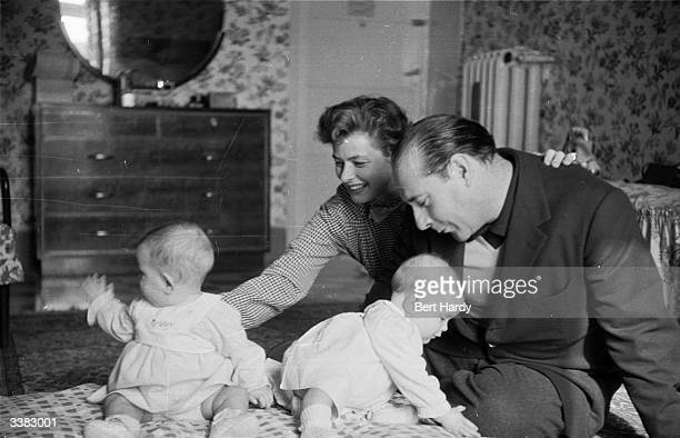 Swedish actress Ingrid Bergman with her husband film director Roberto Rossellini and their 11monthold twins Original Publication Picture Post 6514...