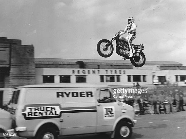 American stuntman Evel Knievel practising jumping over three vans in the car park of Wembley Stadium
