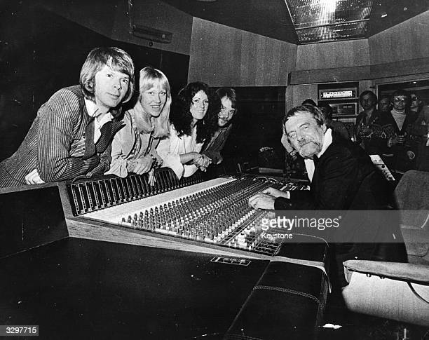 Swedish pop group Abba and their manager Stikkan Andersson at the group's newly completed custombuilt recording studio in Stockholm