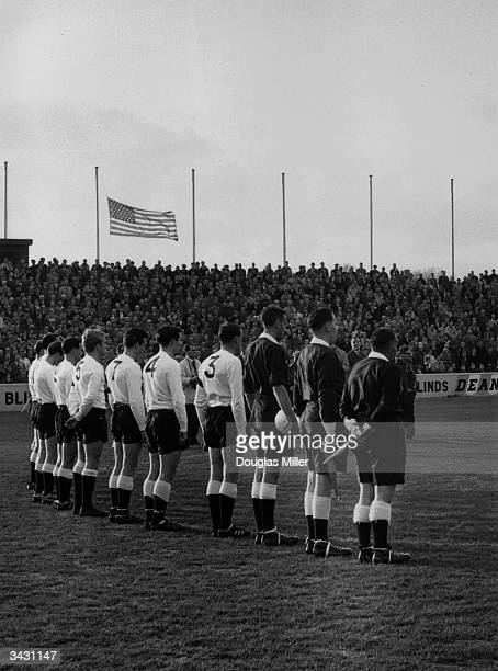 Members of the Fulham team match officials and the crowd standing during a minutes silence out of respect for the assassinated American President...