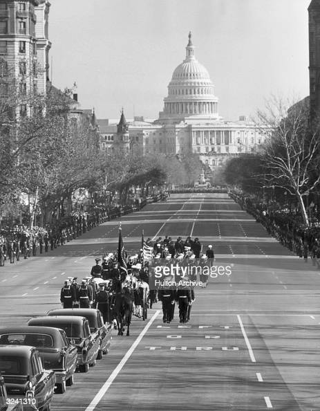 The funeral procession of American president John F Kennedy on Constitution Avenue lined with honor guards and mourners moving toward the US Capitol...